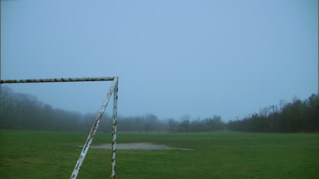 WS soccer field with goal post in fog at dusk / Washington DC, USA