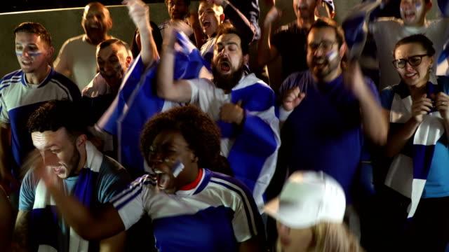 4K: Soccer / Football fans in Stadium celebrating goal being scored