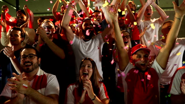Soccer / Football fans in Stadium with confetti / Ticker tape - Super Slow Motion