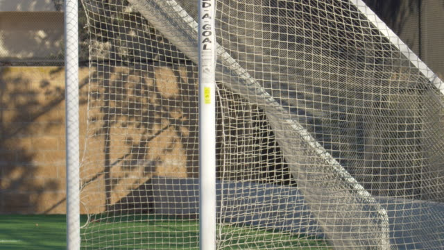 soccer football goal on a turf grass field. - slow motion - football pitch stock videos & royalty-free footage
