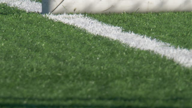 soccer football goal on a turf grass field. - slow motion - turf stock videos & royalty-free footage