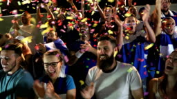 Soccer / Football spectators in Stadium with confetti - Super Slow Motion