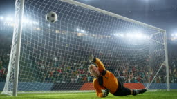 Soccer goalkeeper jumps and catches ball