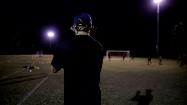 soccer instructor - football pitch stock videos and b-roll footage