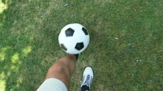 soccer keep-ups pov. - limb body part stock videos & royalty-free footage