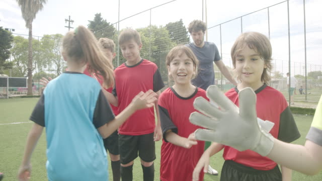 soccer kids players greeting each other in a row before a competition - football team stock videos & royalty-free footage