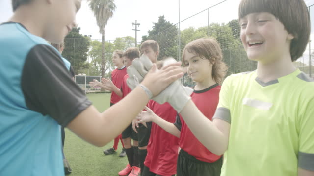 soccer kids players greeting each other in a row before a competition - kids in a row stock videos & royalty-free footage