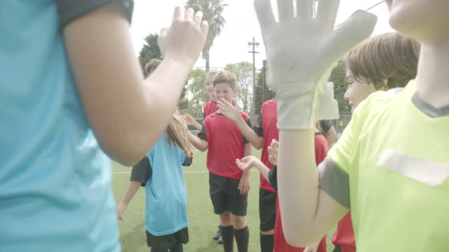 soccer kids players greeting each other in a row before a competition - soccer competition stock videos & royalty-free footage