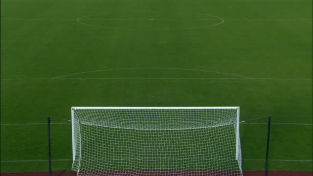 ha ws soccer net on empty soccer field / sheffield, england, uk - football pitch stock videos & royalty-free footage