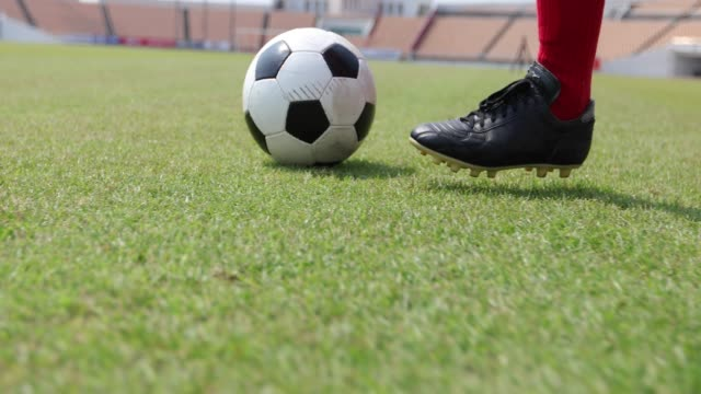 soccer or football player standing with ball on the field for kick the soccer ball at football stadium - competition round stock videos and b-roll footage