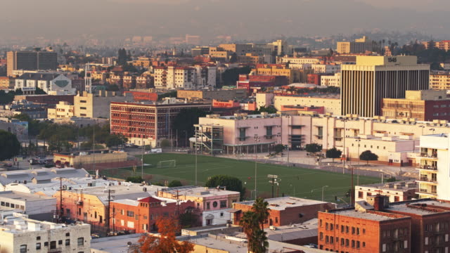 Soccer Pitch Surrounded by Apartment Buildings in Westlake, Los Angeles - Aerial Establishing Shot