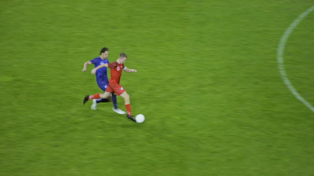 soccer player being tackled by the opponent and falling down - kicking stock videos & royalty-free footage