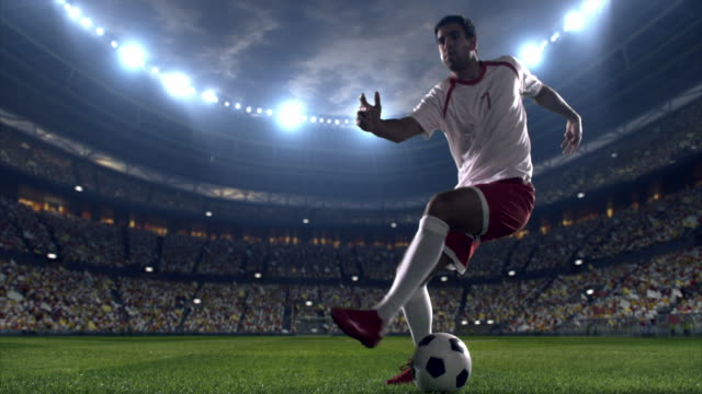 soccer player dribbling a ball on the field - dribbling stock videos & royalty-free footage