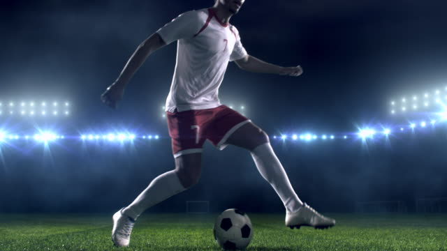soccer player dribbling a ball on the field - bouncing stock videos & royalty-free footage