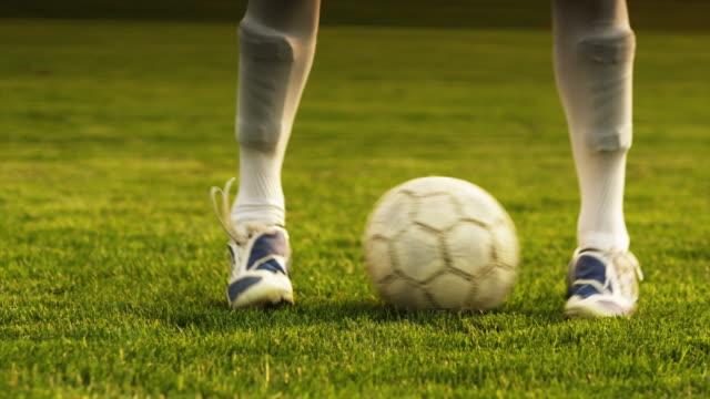 cu soccer player dribbling ball on field / orem, utah, usa - orem utah stock videos & royalty-free footage