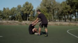 Soccer player helping teammate to get up after foul