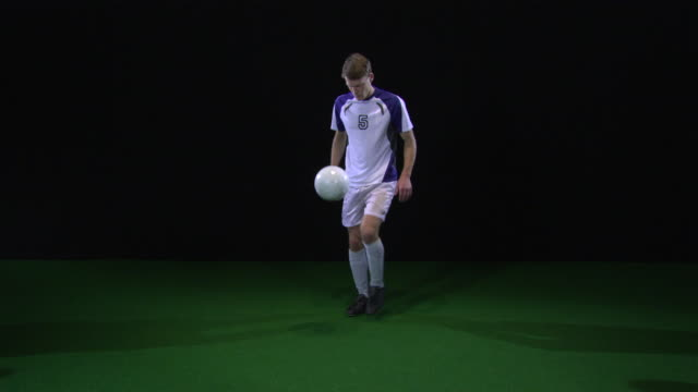 ws soccer player kicking and kneeing ball / berlin, germany - standing stock videos & royalty-free footage