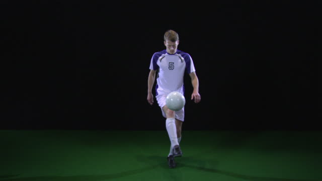 slo mo ws soccer player kicking ball / berlin, germany - football player stock videos & royalty-free footage