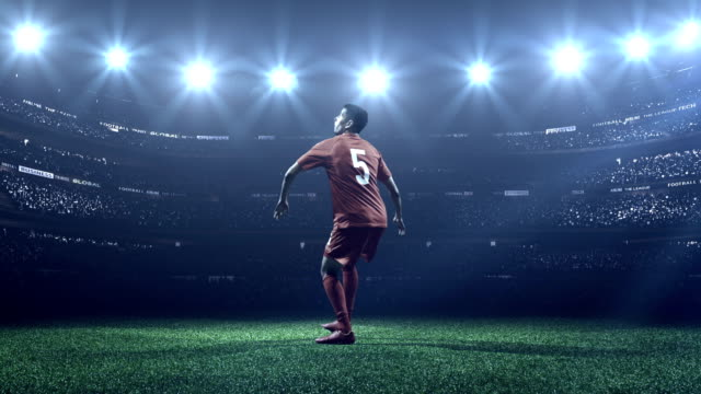 soccer player kicking ball in stadium - goal stock videos & royalty-free footage