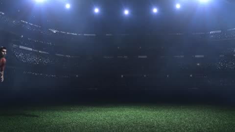 vídeos y material grabado en eventos de stock de jugador de fútbol coleando en el estadio ball - pelota