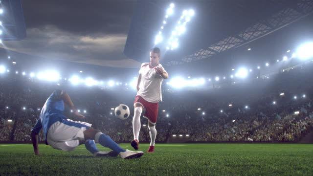 soccer player kicking ball in stadium - twilight stock videos & royalty-free footage