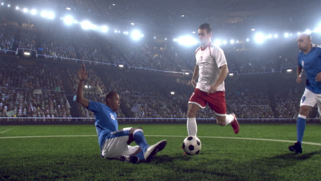 soccer player kicking ball in stadium - tackling stock videos and b-roll footage