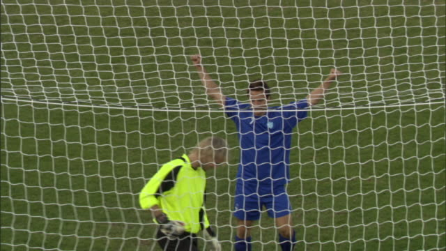 ha ms zo ws zi pan soccer player kicking ball into goal during penalty kick / sheffield, england, uk - soccer goal stock videos and b-roll footage