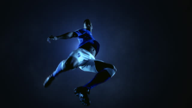 soccer player kicking ball - football player stock videos & royalty-free footage