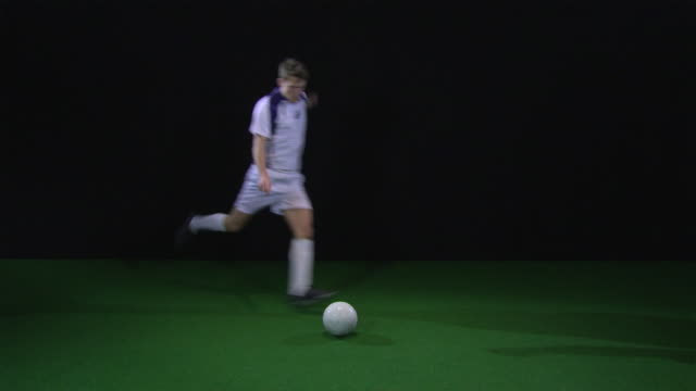 ws soccer player kicking football, clenching fist / berlin, germany - hitting stock videos and b-roll footage