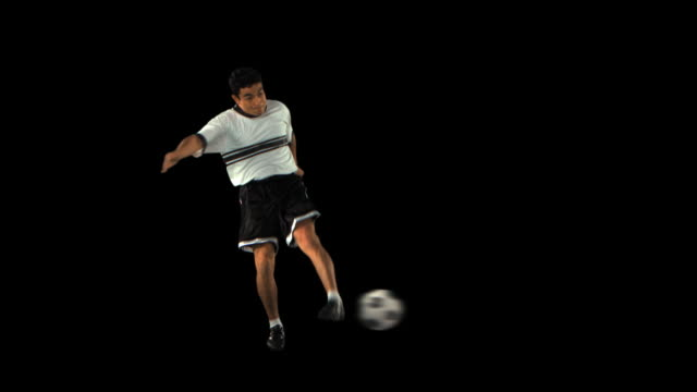 soccer player kicking forward - this clip has an embedded alpha-channel - keyable stock videos & royalty-free footage