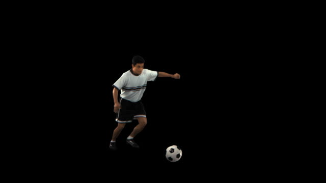 soccer player kicking to side - this clip has an embedded alpha-channel - keyable stock videos and b-roll footage