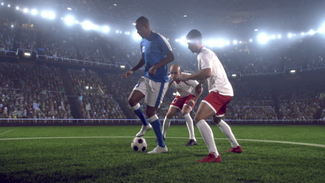 soccer player kicks a ball on stadium - football stock videos & royalty-free footage