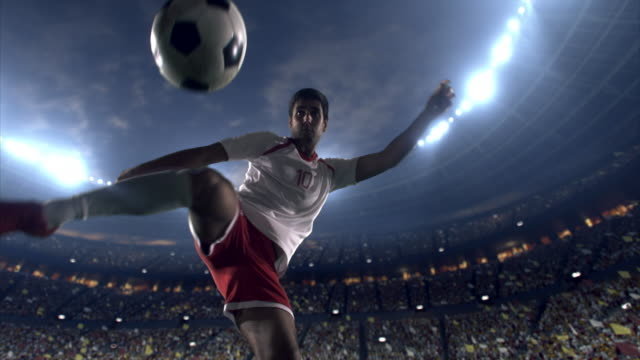 soccer player makes a dramatic play - professional sportsperson stock videos and b-roll footage