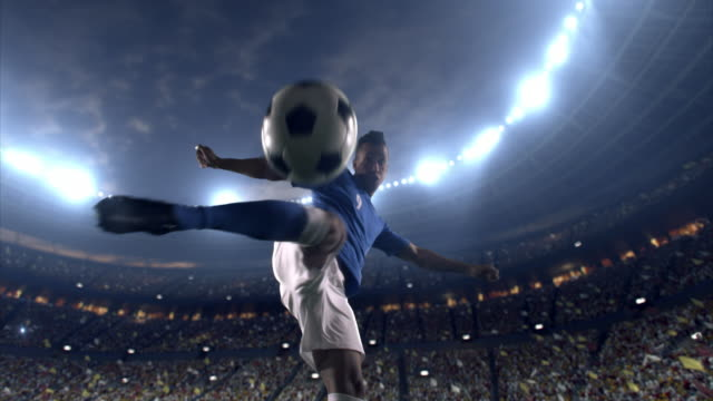 soccer player makes a dramatic play - american football ball stock videos & royalty-free footage