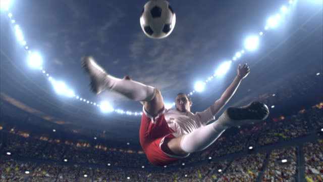soccer player makes a dramatic play - kicking stock videos & royalty-free footage