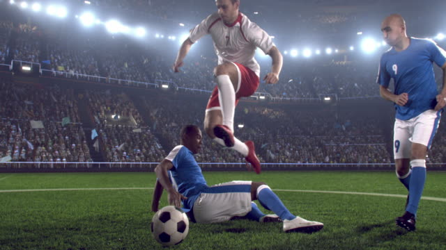 soccer player makes a jump - football pitch stock videos & royalty-free footage