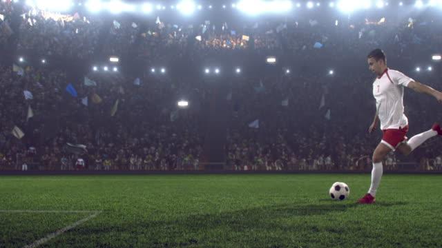 Voetbalspeler maakt een kick