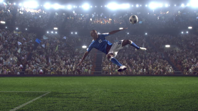 soccer player makes a kick - football pitch stock videos & royalty-free footage