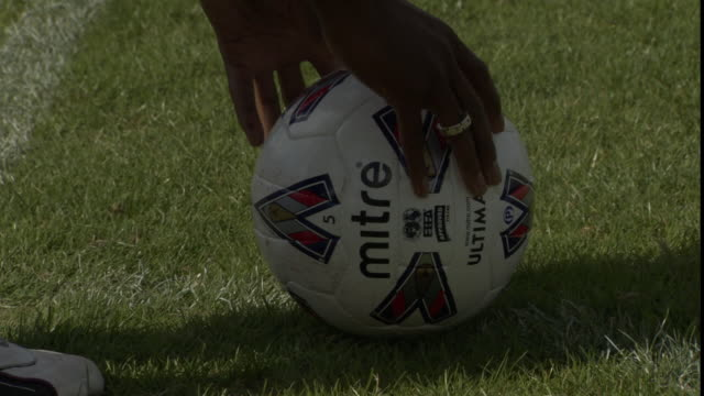 cu soccer player placing ball on field, then kicks it / sheffield, england, uk - putting stock videos & royalty-free footage