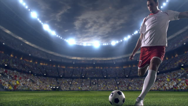 soccer player scores a goal - football stock videos & royalty-free footage