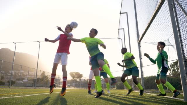 soccer player scoring a goal - geköpft stock-videos und b-roll-filmmaterial