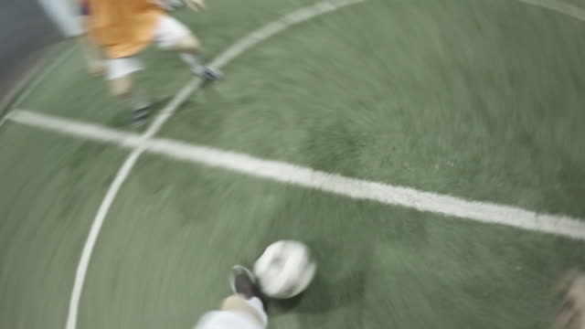 pov of soccer player scoring goal during friendly match - weiblicher teenager stock-videos und b-roll-filmmaterial