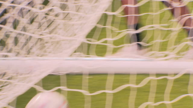 cu soccer player scoring goal, london, uk - netting stock videos and b-roll footage