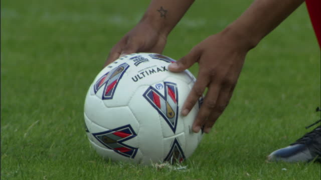 cu soccer player setting ball on grass/ ball being kicked/ sheffield, england - knee highs stock videos and b-roll footage