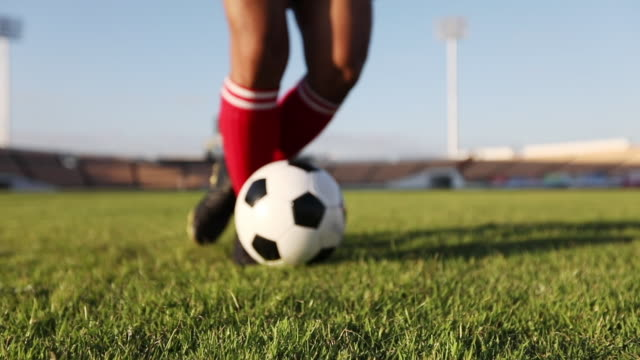 soccer player show footwork and soccer player kicking and shooting ball on goal in slow motion - football pitch stock videos and b-roll footage