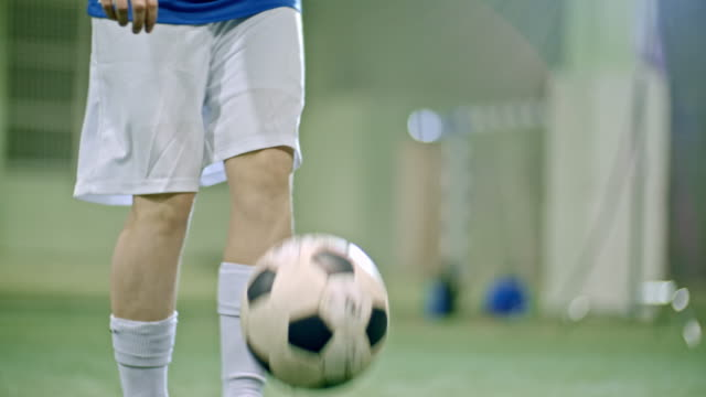 soccer player skillfully juggling ball - indoor soccer stock videos & royalty-free footage
