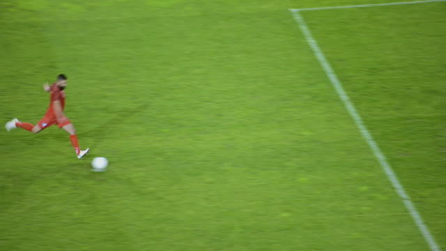 soccer player taking a penalty kick and scoring - goalkeeper stock videos & royalty-free footage