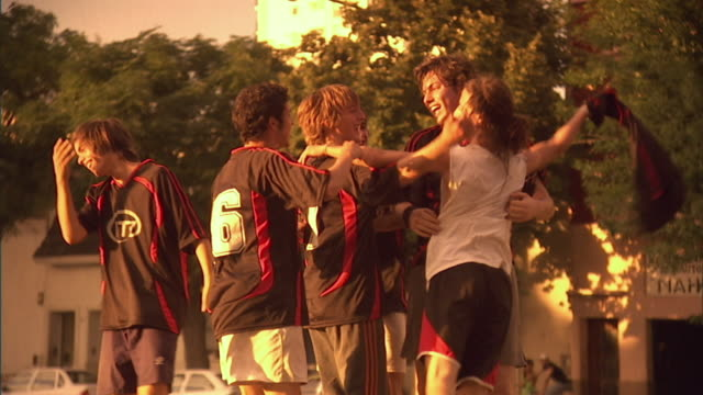 slo mo, ms, pan, zo, soccer players celebrating victory on  field, buenos aires, argentina - vincere video stock e b–roll