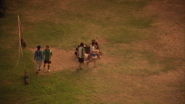 WS, HA, PAN, soccer players falling on each other on field, Buenos Aires, Argentina