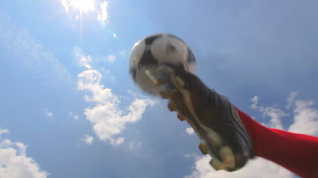 soccer players kick and pass a soccer ball to each other in a circle inside a soccer stadium - trikot stock-videos und b-roll-filmmaterial